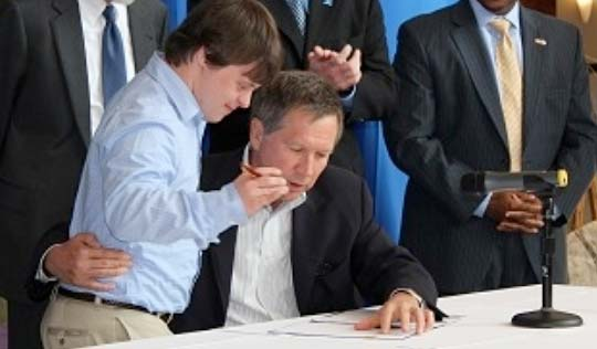 Micah Hetrick assists Governor John Kasich in signing Ohio's Employment First Executive Order, March 2012