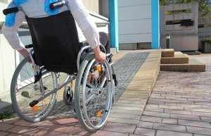 Person in wheelchair going up a ramp