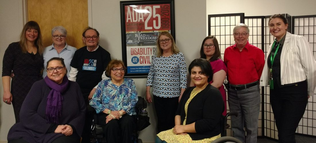 Photo L-R front: Shari Veleba, Judy Heumann, Marly Saade Photo L-R rear: Olivia Caldeira, Debra Petermann, Tom Olin, Sue Hetrick, Jamie Lahrmer, Freddie Weeks, Addie (Judy's assistant)